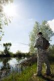 Homme de pêche Photo stock