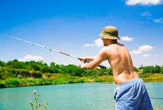 Homme de pêche Photographie stock