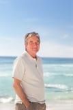 Homme de Pensif sur la plage Photo libre de droits