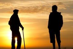 Homme de personne de silhouette de lever de soleil Image libre de droits