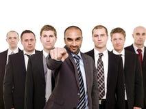 Homme de pointage devant son équipe Images stock