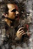Homme de regard dangereux tenant une arme à feu Images libres de droits