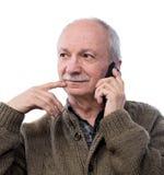 Homme de Seniorsmiling avec le téléphone portable Photographie stock