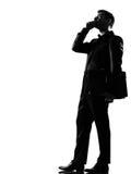 Homme de silhouette au téléphone Photos stock