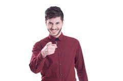 Homme de sourire d'affaires dirigeant le doigt à vous Image libre de droits