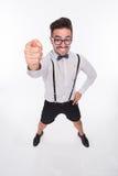 Homme de sourire montrant le doigt moyen Photographie stock libre de droits