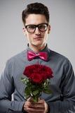 Homme avec des fleurs Photos stock