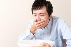 Homme de vomissement Photographie stock libre de droits