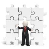 homme des affaires 3d avec des puzzles Photos stock