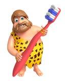 Homme des cavernes avec la brosse à dents Photographie stock libre de droits