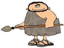 Homme des cavernes avec une lance Photographie stock