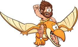 Homme des cavernes montant un ptérodactyle Photos libres de droits