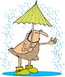 Homme des cavernes sous la pluie Photos stock