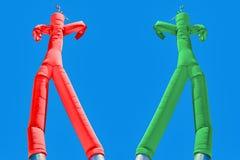Homme deux gonflable Vert et rouge Concept de choix Images stock