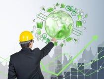 Homme devant des icônes d'énergie d'eco, environnement propre Image stock