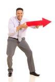 Homme dirigeant le signe de flèche Photo stock