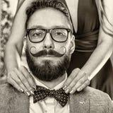 Homme démodé avec une barbe et une moustache courbée Photographie stock libre de droits