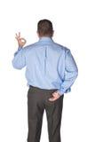 Homme donnant des signaux de main Images stock