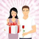 Homme donnant le cadeau à la fille Photographie stock