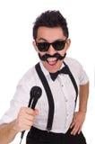 Homme drôle avec la MIC d'isolement sur le blanc Image stock