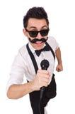 Homme drôle avec la MIC d'isolement sur le blanc Photos libres de droits