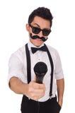 Homme drôle avec la MIC d'isolement sur le blanc Photo libre de droits