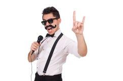Homme drôle avec la MIC d'isolement sur le blanc Photo stock