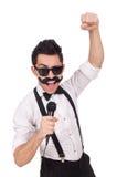 Homme drôle avec la MIC d'isolement sur le blanc Photographie stock libre de droits