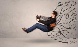 Homme drôle conduisant une machine volante avec les lignes tirées par la main après h Photographie stock libre de droits