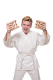 Homme drôle de karaté cassant des briques Photographie stock