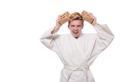 Homme drôle de karaté cassant des briques Image libre de droits