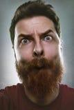 Homme drôle faisant le visage idiot photographie stock