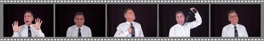Homme drôle dans la cabine de photo de centre commercial Photo libre de droits