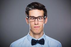 Homme effectuant des visages Photographie stock