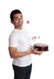 Homme effronté avec un gâteau de coeur d'amour Photos libres de droits