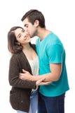 Homme embrassant l'amie sur sa joue Image stock
