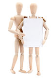 Homme en bois avec le panneau publicitaire porté par un homme-sandwich Photo stock