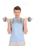 Homme en bonne santé établissant avec les poids libres Image stock