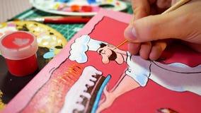Homme en cours de dessin avec la photo de peintures acryliques avec le cuisinier Photos libres de droits
