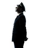 Homme en silhouette d'uniforme de pilote de ligne aérienne Photo stock