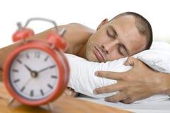 Homme en sommeil avec l'horloge Photographie stock libre de droits