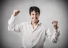 Homme encourageant heureux Photographie stock