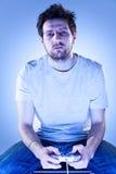 Homme ennuyé avec Gamepad Image libre de droits