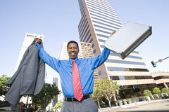 Homme enthousiaste d'affaires avec des bras augmentés Images stock