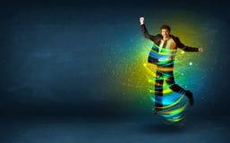 Homme enthousiaste d'affaires sautant avec les lignes colorées d'énergie Photographie stock libre de droits