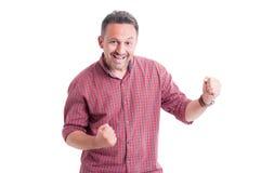 Homme enthousiaste exprimant l'excitation images stock