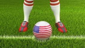 Homme et ballon de football avec le drapeau des Etats-Unis Photo stock