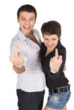 Homme et femme affichant le doigt moyen Image stock