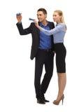 Homme et femme avec des lampes-torches Photographie stock