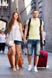 Homme et femme avec des sacs Image stock